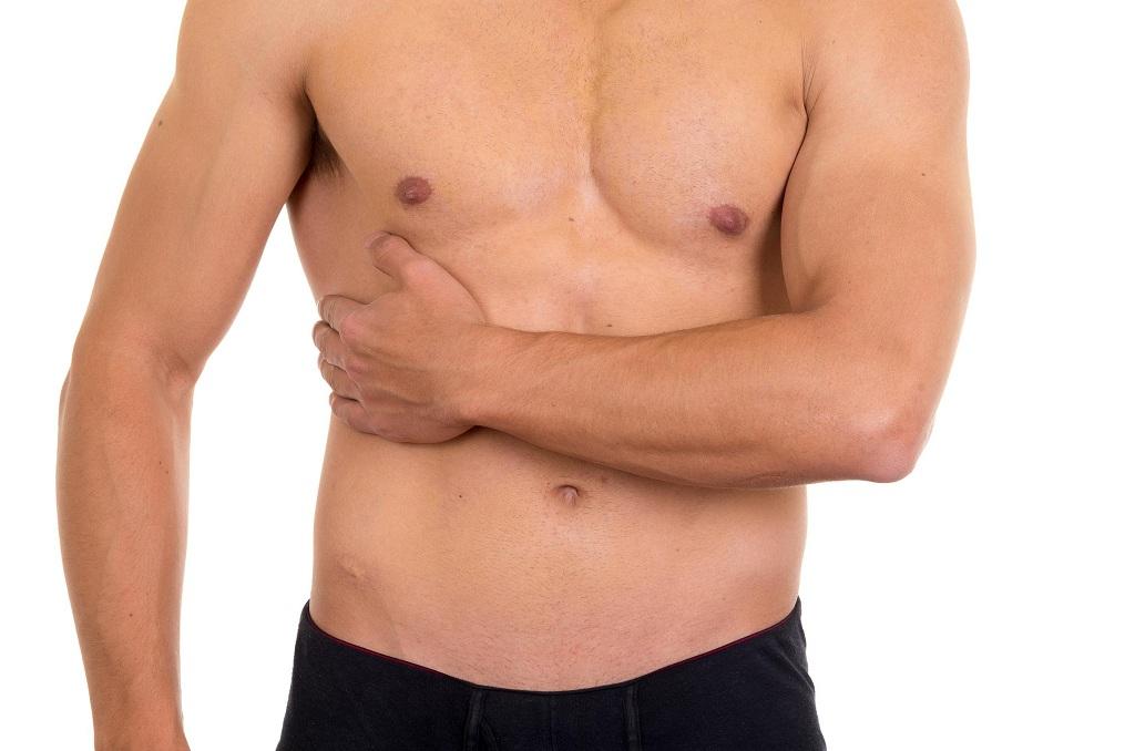 Почему болят бока под ребрами