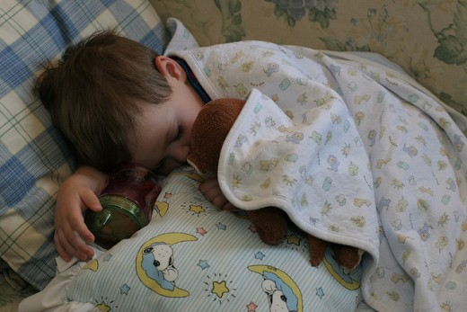 Ребенок в постели