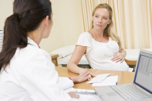 Беременная на приёме у доктора